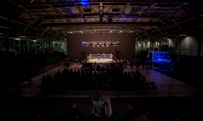 A fighting arena holds two announcers during the 12th Kwon Respect Fighting Championship in Wuppertal, Germany, April 11, 2015. Thirteen fights took place at the event, featuring mixed martial artists, boxers and K-1 kickboxers. (U.S. Air Force photo by Airman 1st Class Timothy Kim/Released)