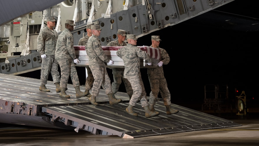 A U.S. Air Force carry team transfers the remains of Tech. Sgt. Anthony E. Salazar of Hermosa Beach, Calif., during a dignified transfer Apr. 17, 2015, at Dover Air Force Base, Del. Salazar was assigned to the 577th Expeditionary Prime Base Engineer Emergency Force Squadron, 1st Expeditionary Civil Engineer Group, U.S. Air Forces Central Command. (U.S. Air Force photo by Airman 1st Class Zachary Cacicia)