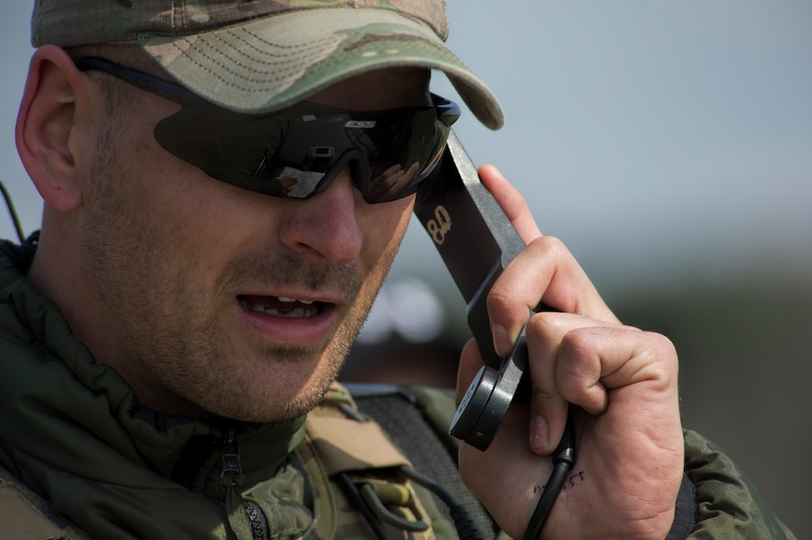 A Czech Republic air force joint terminal attack controller calls in coordinates for close air support to nearby patrolling U.S. Air Force A-10 Thunderbolt II attack aircraft assigned to the 354th Expeditionary Fighter Squadron during a theater security package deployment at Namest Air Base, Czech Republic, April 14, 2015. The U.S. Air Force's forward presence in Europe allows cooperation among NATO allies and partners to develop and improve ready air forces capable of maintaining regional security. (U.S. Air Force photo by Staff Sgt. Christopher Ruano/Released)