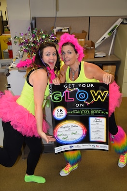 Meaghan Russo, left, and Joanne Perkins of the 377th Force Support Squadron marketing program show their level of commitment to sponsored events by dressing up for a Glow Run. The program won best marketing program in the Air Force. (Courtesy photo)