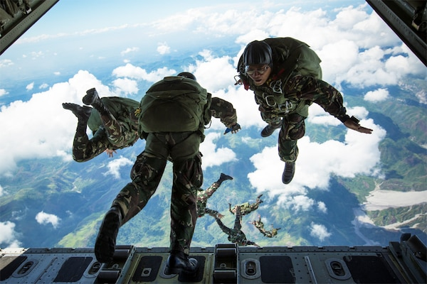 "Philippine Army Special Forces freefall parachutists jump from a KC-130J ""Sumos"" aircraft over Crow Valley, Philippines, May 15, 2014, during high-altitude low-opening jump training at Balikatan 2014. This year is the 31st iteration of Balikatan, an annual Philippines-U.S. military bilateral training exercise. U.S. Marine Corps photo by Lance Cpl. Allison DeVries"