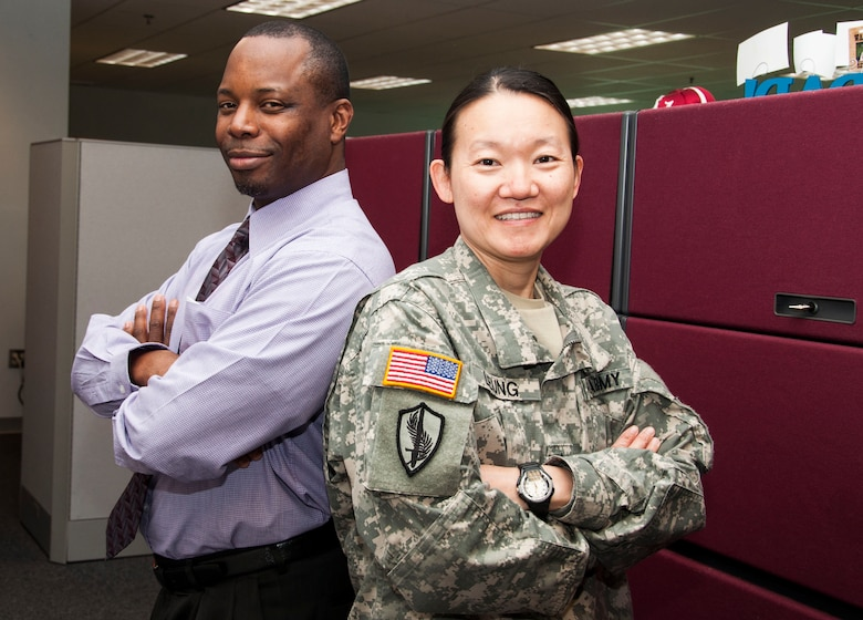 With only a handful of uniformed personnel working side by side with civilians, the work environment at the U.S. Army Corps of Engineers, Middle East District, is quite different from what Soldiers would encounter at their average duty station.  Though Soldiers come to work in uniform each