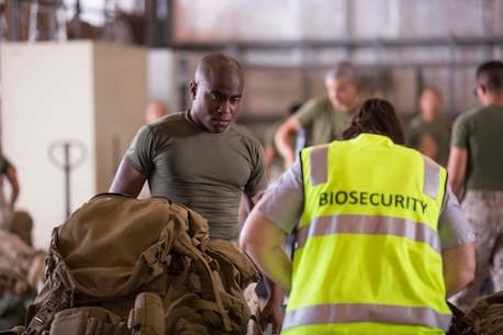 Lance Corporal John Porter has his gear inspected upon arrival April 14 to Royal Australian Air Force Base Darwin, Darwin, Australia, to begin Marine Rotational Force – Darwin 2015. Approximately 20 percent of Marines' gear was inspected by the biosecurity officers with the Australian Department of Agriculture for any foreign soil, plants or seeds. MRF-D is the deployment of U.S. Marines to Darwin and the Northern Territory, for approximately six months at a time, where they will conduct exercises and training on a rotational basis with the Australian Defence Force. Porter, a Chicago, Illinois, native, is a rifleman with Company B, 1st Battalion, 4th Marine Regiment, Marine Rotational Force - Darwin.