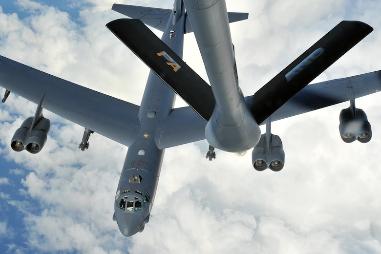 A 20th Expeditionary Bomb Squadron B-52 Stratofortress aircrew detaches from a KC-135 Stratotanker, from the Pittsburgh International Airport Air Reserve Station, Pa., after refueling in the Asia-Pacific region April 16, 2015. The B-52 crews are deployed from Barksdale Air Force Base, La., to Andersen AFB, Guam, in support of U.S. Pacific Command's Continuous Bomber Presence to strengthen regional security and stability. (U.S. Air Force photo by Staff Sgt. Melissa B. White/Released)