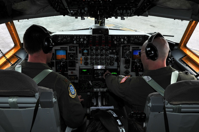 Maj. Scott Fisher, 506th Expeditionary Aerial Refueling Squadron pilot, and 1st Lt. Brandon Rader, 506th EARS co-pilot, implement a preflight checklist prior to departing Andersen Air Force Base, Guam, April 16, 2015, on a KC-135 Stratotanker aerial refueling mission. The tankers routinely support B-52 Stratofortress aircrews with refueling in support of U.S. Pacific Command's Continuous Bomber Presence in the Asia-Pacific region. Fisher and Rader are deployed to Andersen Air Force Base from the Pittsburgh International Airport Air Reserve Station, Pa. (U.S. Air Force photo by Staff Sgt. Melissa B. White/Released)