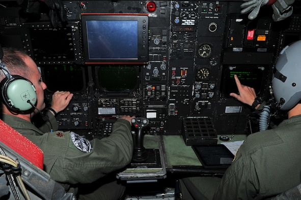 Maj. Andrew Marshall, 20th Expeditionary Bomb Squadron radar navigator, and 1st Lt. Bryant Curdy, 20th EBS navigator, implement an in-flight checklist during a B-52H Stratofortress training mission in the Asia-Pacific region April 15, 2015. The B-52 crews are deployed from Barksdale Air Force Base, La., to Andersen AFB, Guam, in support of U.S. Pacific Command's Continuous Bomber Presence to strengthen regional security and stability. (U.S. Air Force photo by Staff Sgt. Melissa B. White/Released)