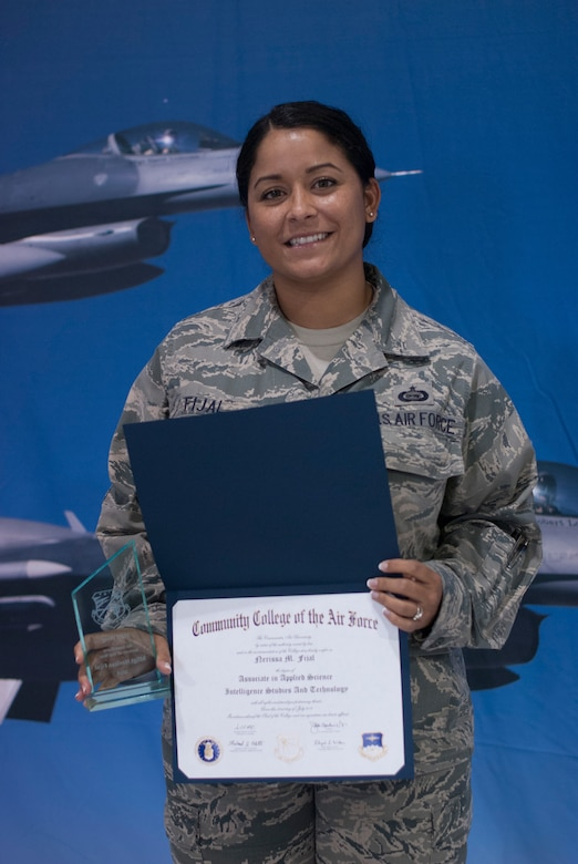Master Sgt. Narissa Fijal, an intelligence analyst in the wing's operations group, received two prestigious awards and was presented with her CCAF diploma during the 162nd Wing awards ceremony on April 12. (U.S. Air National Guard photo by Staff Sgt. Heather Davis)