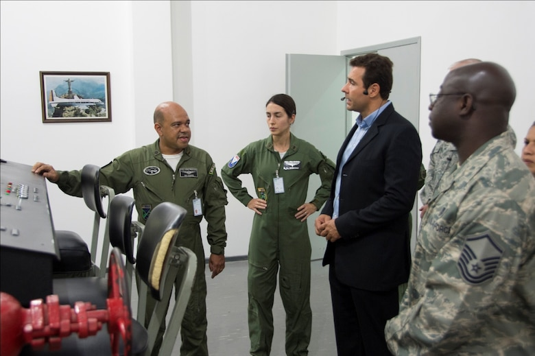 Members of the Brazilian air force give a brief presentation to U.S. Air Force members explaining the use and operation of their hypobaric chamber, April 20, 2015 in Rio de Janeiro, Brazil. The chamber simulates a high altitude environment and helps illustrate the effects of hypoxia on the human body. (U.S. Air Force photo by Staff Sgt. Adam Grant/Released)