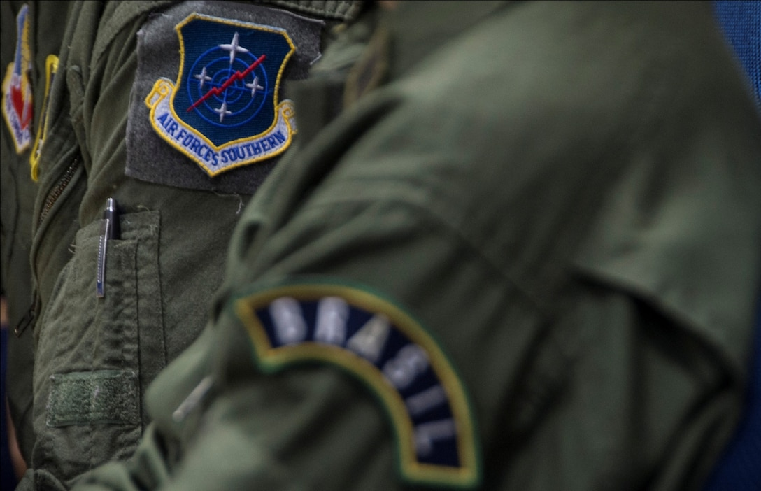 Members from Air Forces Southern and the Brazilian air force sit and discuss topics about the Expeditionary Medical Support training on April 20, 2015 in Rio de Janeiro, Brazil. Some of the topics discussed were the level of training needed for technicians setting up the EMEDS and the amount of patients that could be treated in an EMEDS. (U.S. Air Force photo by Staff Sgt. Adam Grant/Released)