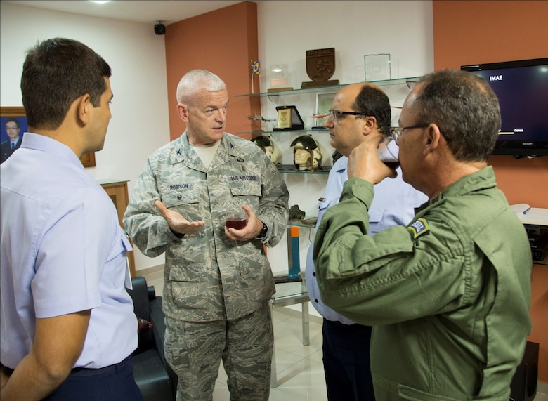 Col. Elmo Robison, Headquarters Air Force chief of expeditionary operations and policy, speaks with members of the Brazilian air force during a brief break after presentations on April 20, 2015 in Rio de Janeiro, Brazil. Robinson is a part of a six person team whose goals are aimed at building partner capacity by enabling regional security through sustained engagement in order to deter adversaries, preserve stability, support allies and partners, and cooperate with others to address common security challenges. (U.S. Air Force photo by Staff Sgt. Adam Grant/Released)