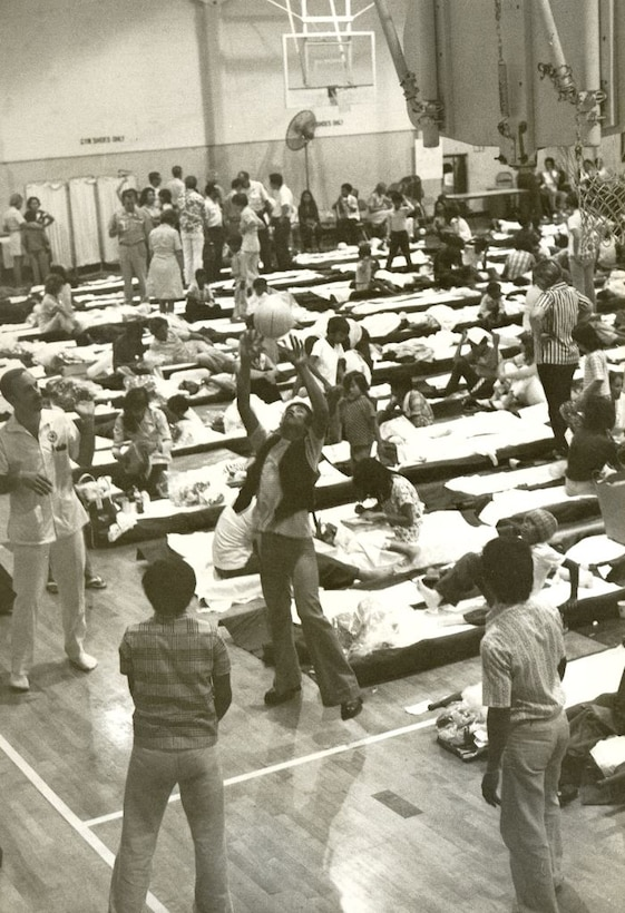 During Operation New Life,  to accommodate flights with longer layovers litters were set up on the Hickam Air Force Base, Hawaii,  gymnasium floor. The practice became common in late April and throughout May 1975 due to the increasing number of refugees. Operation New Life, ran from April 23 to November 1, 1975, airlifting over 100,000 evacuees and refugees from South Vietnam. (U.S. Air Force photo provided by 15 WG historian office)