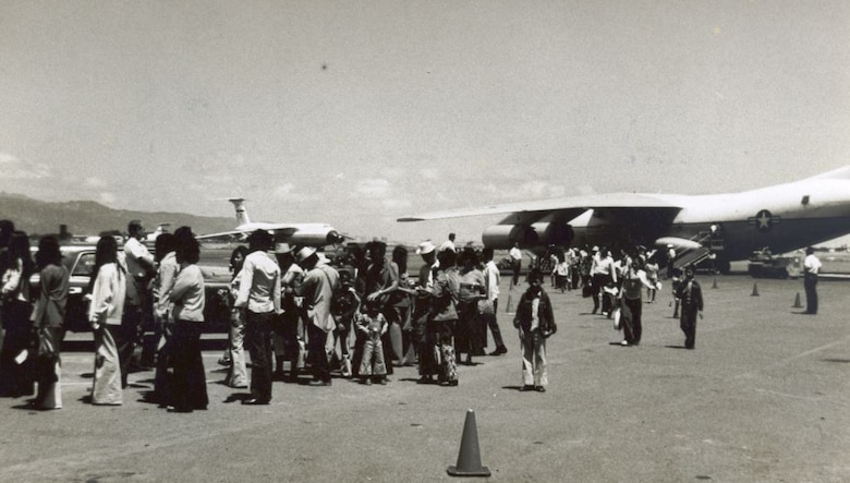 Refugees fleeing South Vietnam in 1975 streamed across the flightline on Hickam Air Force Base, Hawaii, after arriving on C-141 aircraft during Operation New Life. Operation New Life ran from April 23- November 1, 1975, airlifting over 100,000 evacuees and refugees from South Vietnam.(U.S. Air Force photo provided by 15 WG historian office)