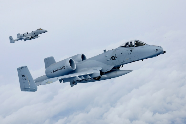 150411-Z-EZ686-183 -- A-10 Thunderbolt II aircraft from Selfridge Air National Guard Base seen in flight while deploying to Southwest Asia earlier in April. The aircraft are flown by the 107th Fighter Squadron at Selfridge. (U.S. Air National Guard photo by Master Sgt. David Kujawa)