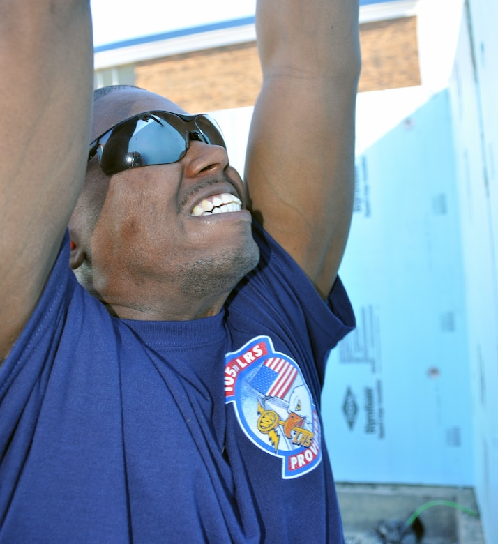 New York Air National Guard Tech. Sgt. Michael Winfield, president of the 105th Logistics Readiness Squadron First Six Council, an organization for junior Airmen, installs insulation at a Habitat for Humanity Project in Newburgh, N.Y., Saturday, April 18, 2015. Twelve members of the council used their off-duty time to support the local project. The 105th Airlift Wing is based at Stewart Air National Guard Base in Newburgh. (U.S. Air National Guard photo by Maj. Patrick Cordova/Released)