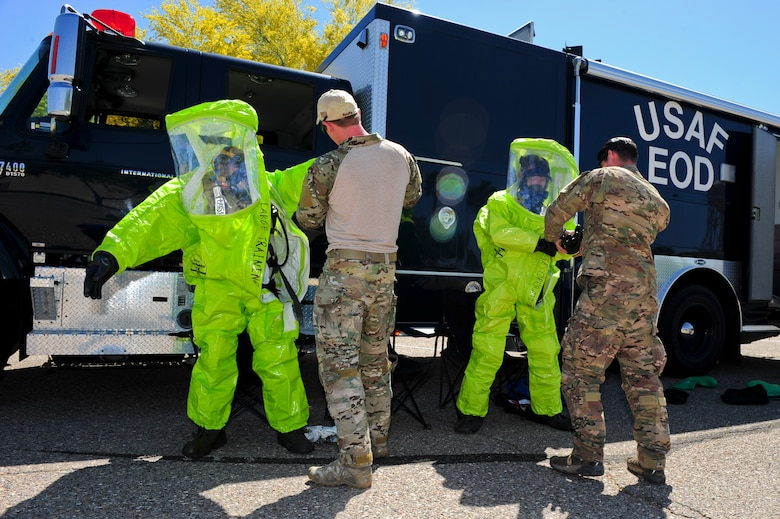 Members of the 355th Civil Engineering Squadron's Explosive Ordnance Disposal flight dress in Level A chemical suits during a weapons of mass destruction training exercise at Davis-Monthan Air Force Base, Ariz., April 8, 2015. The Level A suits offer the highest level of protection against harmful vapors, gases and particles. (U.S. Air Force photo by Airman 1st Class Chris Drzazgowski/Released)