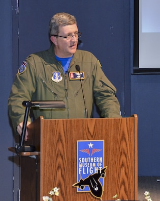 Col. Scott Grant the 117th Air Refueling Wing Vice Commander speaks at the Southern Museum of Flight during a reception held to honor survivors and family members of the Bay of Pigs invasion in Cuba.(U.S. Air National Guard photo by: Senior Master Sgt. Ken Johnson/Released)