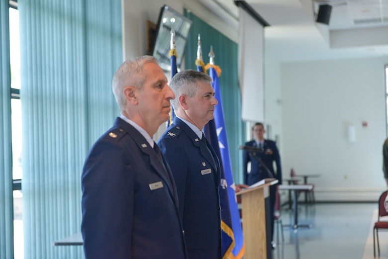 Lt. Col. Alan Ross (left), 109th Airlift Wing vice commander, and Col. Shawn Clouthier, 109th AW commander, stand at attention as Ross' promotion order to colonel is read during his promotion ceremony at Stratton Air National Guard Base, New York, on April 19, 2015. Ross took over as vice commander in October of 2014. (U.S. Air National Guard photo by Mater Sgt. William Gizara/Released)