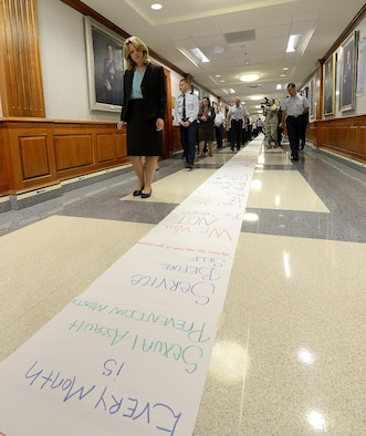 Secretary of the Air Force Deborah Lee James reads messages created by Air Staff members who lined the Arnold Corridor in recognition of Sexual Assault Awareness and Prevention, in the Pentagon, April 20, 2015. The Air Force's senior leaders hosted the short hallway event to send the message, that while the official SAAPM concluded, sexual assault prevention is all year long. (U.S. Air Force photo/Scott M. Ash)