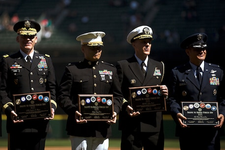 SEATTLE -- Maj. Sung Kim (second from left), the commanding officer of Marine Corps Recruiting Station Seattle, poses with local military leaders after being honored before a Seattle Mariners' Salute to Armed Forces game at Safeco Field here, April 19, 2015. The event included the presentation of commemorative plaques to senior military leaders, a joint-service color guard and flag presentation, military band performances and ceremonial first pitches thrown out by members of each service. (U.S. Marine Corps photo by Sgt. Reece Lodder)