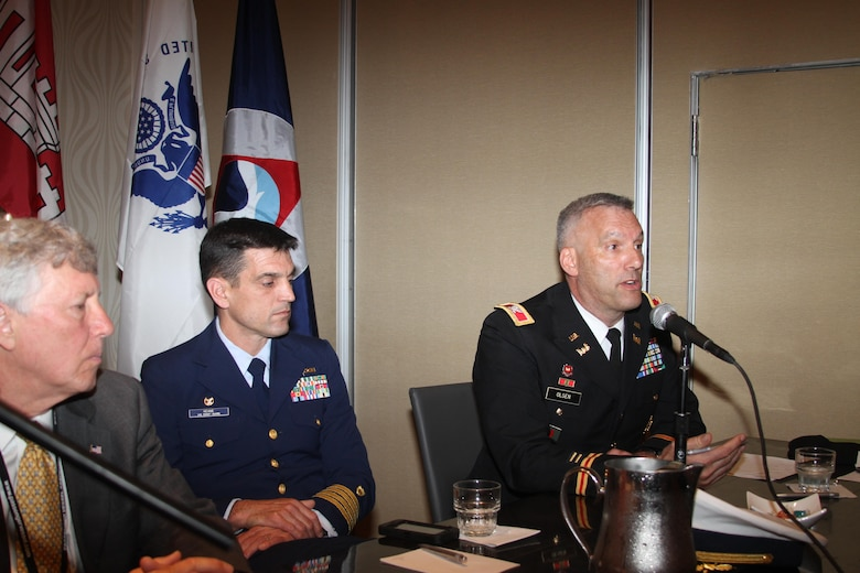 Colonel Paul Olsen, U.S. Army Corps of Engineers' Norfolk District commander, provides opening remarks for the 2015 Mid-Atlantic Waterways Conference ongoing through April 23, at the Portsmouth-Norfolk Renaissance Waterfront Hotel in Portsmouth, Va. Joining him is Arthur W. Moye Jr., executive vice president, Virginia Maritime Association and Captain Christopher Keane, U.S. Coast Guard commander, Sector Hampton Roads.