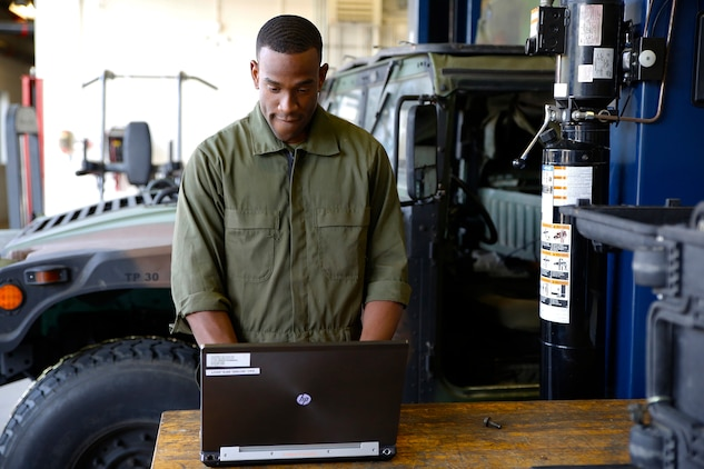 Lance Cpl. Cedric Hargrove enters data into Global Combat Support System-Marine Corps using a laptop in a motor bay at The Basic School aboard Marine Corps Base Quantico, Va. Thanks to a recent GCSS-MC software update, Marines will be able to make better use of the logistics and resource management software system in limited-connectivity environments.