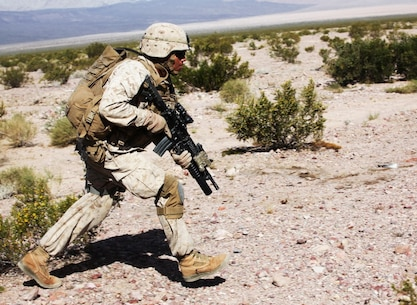 Lance Cpl. Anthony Teyuca, a team leader with Company A, 1st Battalion, 7th Marine Regiment, 1st Marine Division, bounds toward a notional objective during a notional mechanized raid during Exercise Desert Scimitar 15, April 16, 2015. Desert Scimitar is designed to provide tough, realistic live-fire training that allows the 1st Marine Division to improve combat effectiveness and meet current and real-world operational demands.