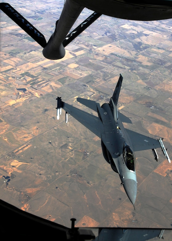 A 114th Fighter Wing F-16 Fighting Falcon rendezvoused with a KC-135R Stratotanker from the 185th Air Refueling Wing, Sioux City, IA, during an air refueling training mission that took off from Joe Foss Field, S.D., April 11, 2015. The 114th Fighter Wing and South Dakota Employer Support of the Guard and Reserve (ESGR) hosted a Boss Lift to provide employers an opportunity to see first-hand what citizen-Airmen experience while away from work to attend military training or activated for a federal or state mission.(National Guard photo by Staff Sgt. Luke Olson/Released)