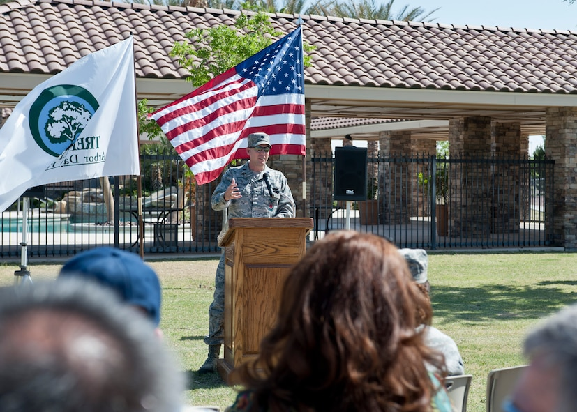 Lt. Col. Brian Hartless, 99th Civil Engineer Squadron commander, provides opening remarks during the Earth and Arbor Day 2015 celebration at Nellis Air Force Base, Nev., April 20, 2015. The annual celebration ceremony was held to show the installation is committed to the development of renewable energy through pollution-prevention efforts, energy conservation, and sustainability. (U.S. Air Force photo by Airman 1st Class Jake Carter)