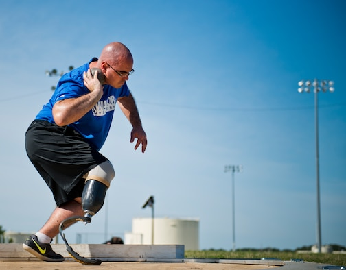Jason Caswell, an Air Force Wounded Warrior athlete, prepares to launch his throw at a shot put practice during the fourth day of the Warrior Games training camp at Eglin Air Force Base, Fla., April 21. The five-day training camp for the Air Force's athletes serves as their last practice session before the Warrior Games June 19-28. (U.S. Air Force photo/Samuel King Jr.)