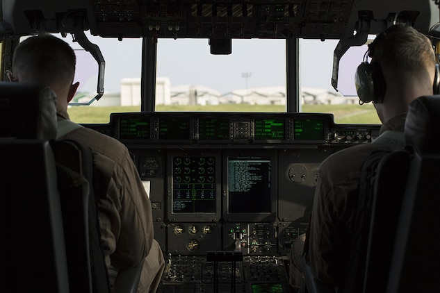 Capt. Charles Casey, left, an aircraft commander with Marine Aerial Refueler Transport Squadron 152, and 1st Lt. Jacob Billups, a pilot with VMGR-152, prepare to take flight to Iwo To, formally known as Iwo Jima, from Kadena Air Base, Japan, March 22, 2015. VMGR-152 provided transportation for Marines, VIPs and vehicles. The Reunion of Honor is a ceremony honoring veterans still alive from the battle of Iwo Jima in 1945.