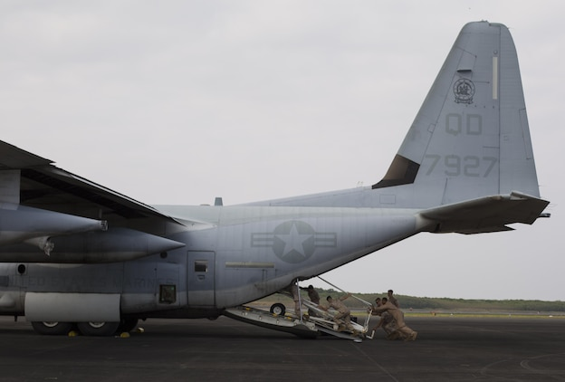 Marines with Marine Aerial Refueler Transport Squadron 152 load a staircase onto a Lockheed KC-130J Hercules after the Reunion of Honor Ceremony on Iwo To, formally known as Iwo Jima, March 21, 2015. The Reunion of Honor is a ceremony honoring veterans still alive from the battle of Iwo Jima in 1945. VMGR-152 provided transportation for Marines, VIPs and vehicles in support of the reunion this year.