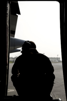 Cpl. Eli Wallace, a crew master with Marine Aerial Refueler Transport Squadron 152, awaits for take-off on a Lockheed KC-130J Hercules on Kadena Air Base, Japan, March 22, 2015. VMGR-152 flew back and forth from Kadena to Iwo To, formally known as Iwo Jima, providing transportation for Marines, VIPs and vehicles. The Reunion of Honor is a ceremony honoring veterans still alive from the battle of Iwo Jima in 1945.
