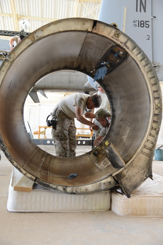 An Airman with the 332nd Expeditionary Maintenance Group prepares a damaged nacelle, the protective covering on the engine, from an A-10C Thunderbolt II for shipment at Al Asad Air Base, Iraq. A maintenance response team from the 332nd EMXG repaired the jet and got it back in the air less than five days after the jet suffered catastrophic engine failure and had to divert there. (U.S. Air Force photo by Tech. Sgt. Jared Marquis/released)