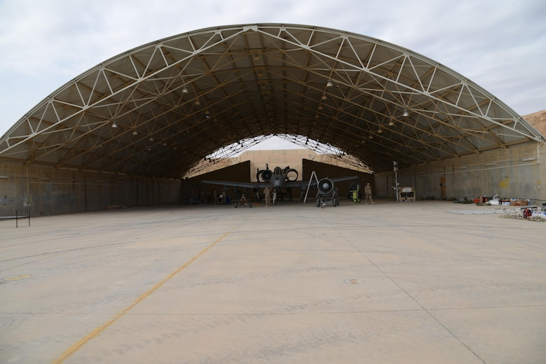 Airmen from the 332nd Expeditionary Maintenance Squadron work in an abandoned aircraft shelter at Al Asad Air Base, Iraq to repair an A-10C Thunderbolt II that suffered catastrophic engine failure. A maintenance response team from the 332nd EMXG repaired the jet and got it back in the air less than five days after the jet suffered catastrophic engine failure and had to divert there. (U.S. Air Force photo by Tech. Sgt. Jared Marquis/released)