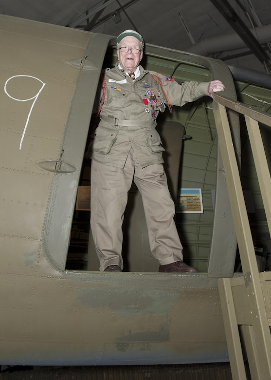 George Shenkle stands in the troop doorway of a C-47A Skytrain April 18, 2015, at the Air Mobility Command Museum near Dover Air Force Base, Del. Shenkle jumped out of this exact door on D-Day, June 6, 1944, over Sainte-Mère-Église in Normandy, France. (U.S. Air Force photo/Airman 1st Class Zachary Cacicia)