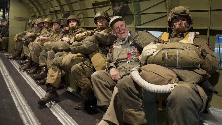 George Shenkle (second from right) sits with reenactors depicting World War II-era paratroopers from the 82nd Airborne Division inside a C-47A Skytrain April 18, 2015, at the Air Mobility Command Museum near Dover Air Force Base, Del. Shenkle is sitting in the same seat position on the very aircraft that he jumped out of on D-Day, June 6, 1944, over Normandy, France. (U.S. Air Force photo/Airman 1st Class Zachary Cacicia)
