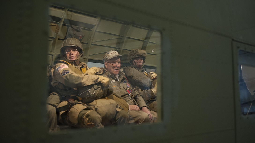 George Shenkle (center) sits between Daniel Dillier and Christian Holland, reenactors depicting World War II-era paratroopers from the 82nd Airborne Division, onboard a C-47A Skytrain April 18, 2015, at the Air Mobility Command Museum near Dover Air Force Base, Del. (U.S. Air Force photo/Airman 1st Class Zachary Cacicia)