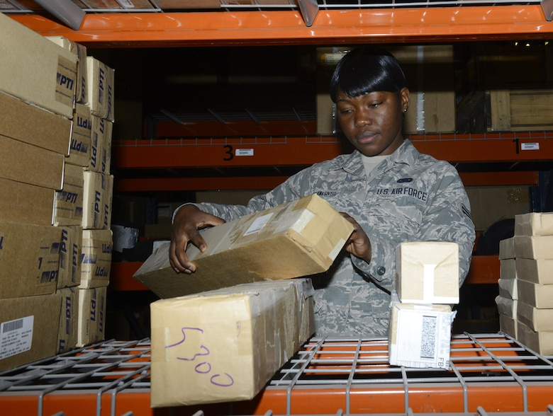 Airman 1st Class Bernice Yunwe Kwasinyui, a 22nd Logistics Readiness Squadron aircraft parts store technician, looks up part information April 22, 2015, at McConnell Air Force Base, Kan. Yunwe Kwasinyui, a Cameroon native, joined the Air Force to give back to the country that gave her an opportunity for a better life. (U.S. Air Force photo/Senior Airman Trevor Rhynes)