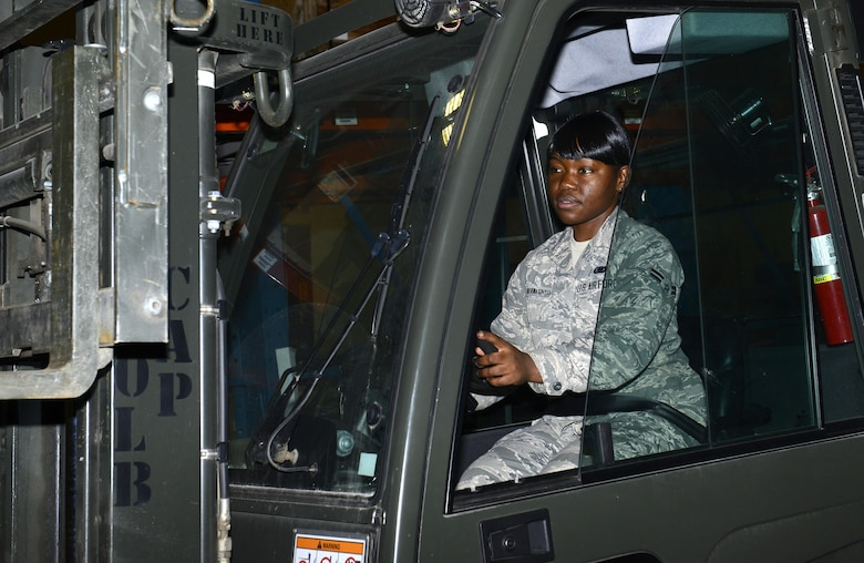 Airman 1st Class Bernice Yunwe Kwasinyui, a 22nd Logistics Readiness Squadron aircraft parts store technician, operates a forklift April 22, 2015, at McConnell Air Force Base, Kan. Yunwe Kwasinyui, left her home country of Cameroon after she won a visa to come to the U.S. (U.S. Air Force photo/Senior Airman Trevor Rhynes)