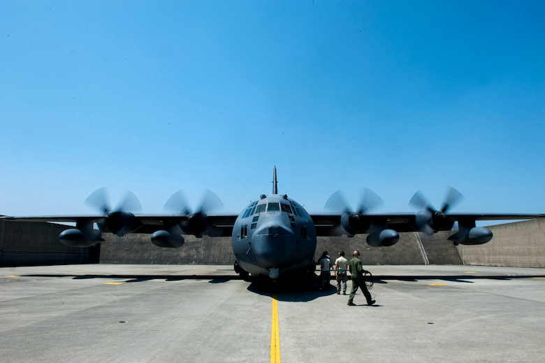 """The MC-130P Combat Shadow team performs the final checks before takeoff on Kadena Air Base, Japan, April 15, 2015. The 17th Special Operations Squadron sent off the final two Combat Shadows in the Pacific Air Forces to retire to the """"boneyard"""" at Davis-Monthan Air Force Base, Ariz. (U.S. Air Force photo/Airman 1st Class Stephen G. Eigel)"""