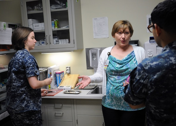 Jennifer Holden, Naval Hospital Camp Pendleton immunizations program nurse manager, discusses proper vaccine processes with sailors working in the NHCP Family Medicine Department's immunization clinic during a recent survey.
