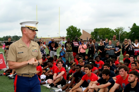 Major Robert  C. Arbegast,  the Commanding Officer of Recruiting Station Houston, speaks about leadership on and off the field to the young men participating in the Semper Fidelis All-American Football Camp at Westfield High School. Semper Fidelis All-American Camps are the first phase of the Semper Fidelis Football Program. From mid-March through the end of June, 2015, 1-day football camps will be in 24 cities across the country. Open to high schools students in 9th, 10th and 11th grade, Semper Fidelis All-American Camps not only hone football skills, but teach players about Marine Corps values both on and off the field. (U.S. Marine Corps photo by Sgt. Gabrielle Bustos)