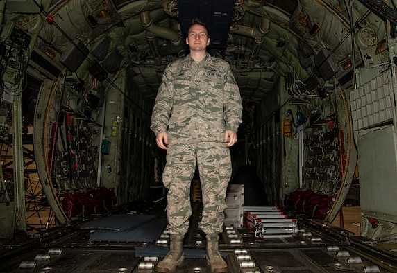 Tech. Sgt. Eric Sims, a 314th Aircraft Maintenance Squadron hydraulic systems craftsman, stands in the back of a C-130H April 17, 2015, at Little Rock Air Force Base, Ark. Sims was awarded the 2014 Air Force Lt. Gen. Leo Marquez Maintenance Award. (U.S. Air Force photo by Senior Airman Harry Brexel)