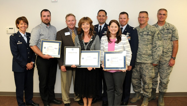 Senior Airman Colton Griffin, a member of the Utah Air National Guard's 151st Maintenance Squadron, presented a Patriot Award to three of his civilian supervisors at bChannels Inc. in Orem, Utah on April 21, 2015. Dustin Daley, Anne-Marie Mickelsen, and Sue Fahnert were each recognized by the Employer Support of the Guard and Reserve after Griffin nominated them for their outstanding support of his military commitments. As part of the ceremony, bChannels also signed an ESGR Statement of Support expressing its support for employees serving in the Guard and Reserve. (Air National Guard photo by Tech. Sgt. Amber Monio/RELEASED)