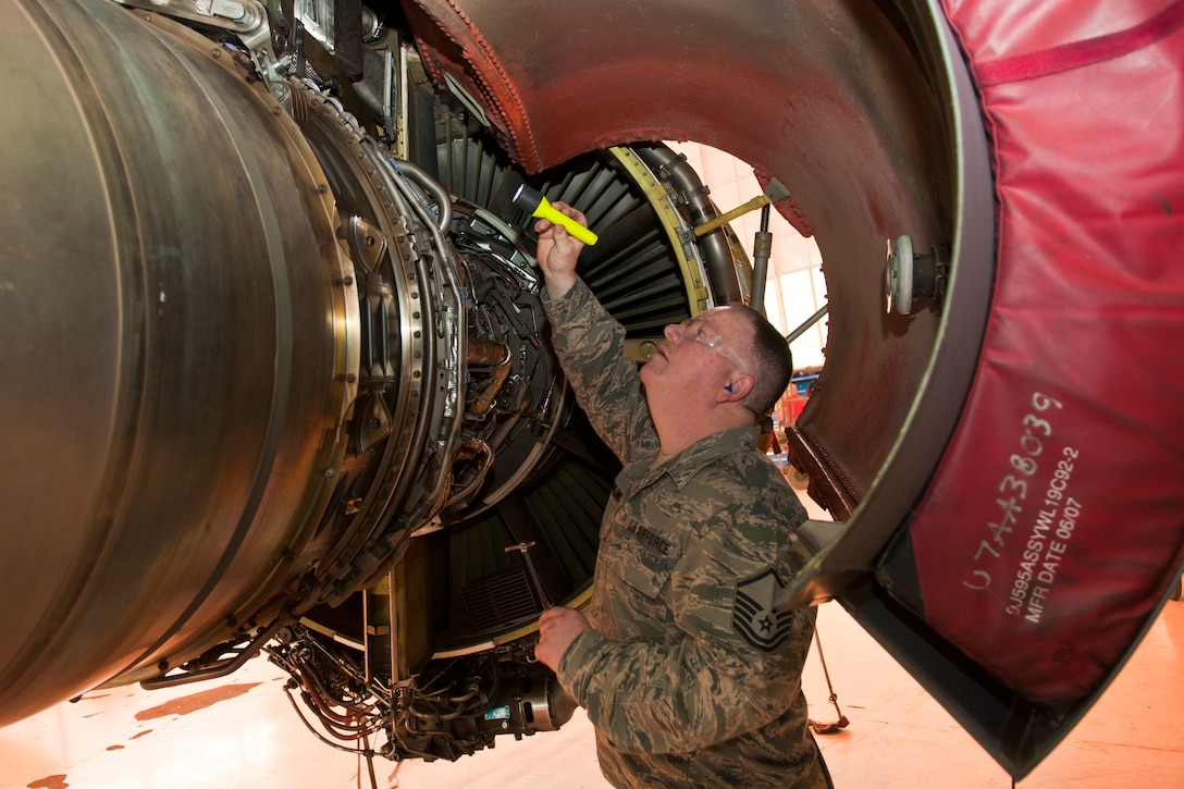 U.S. Air Force Master Sgt. Mark Rawlins, crew chief, 121st Air Refueling Wing, performs an inspection on a KC-135 Stratotanker during depot maintenance as part of Operation Team Spirit, Tinker Air Force Base, Okla., Mar. 2, 2015. The program teams up unit maintenance Airmen with depot facility personnel to perform inspections on aircraft as part of the depot maintenance process. (U.S. Air National Guard photo by Senior Airman Wendy Kuhn/Released)