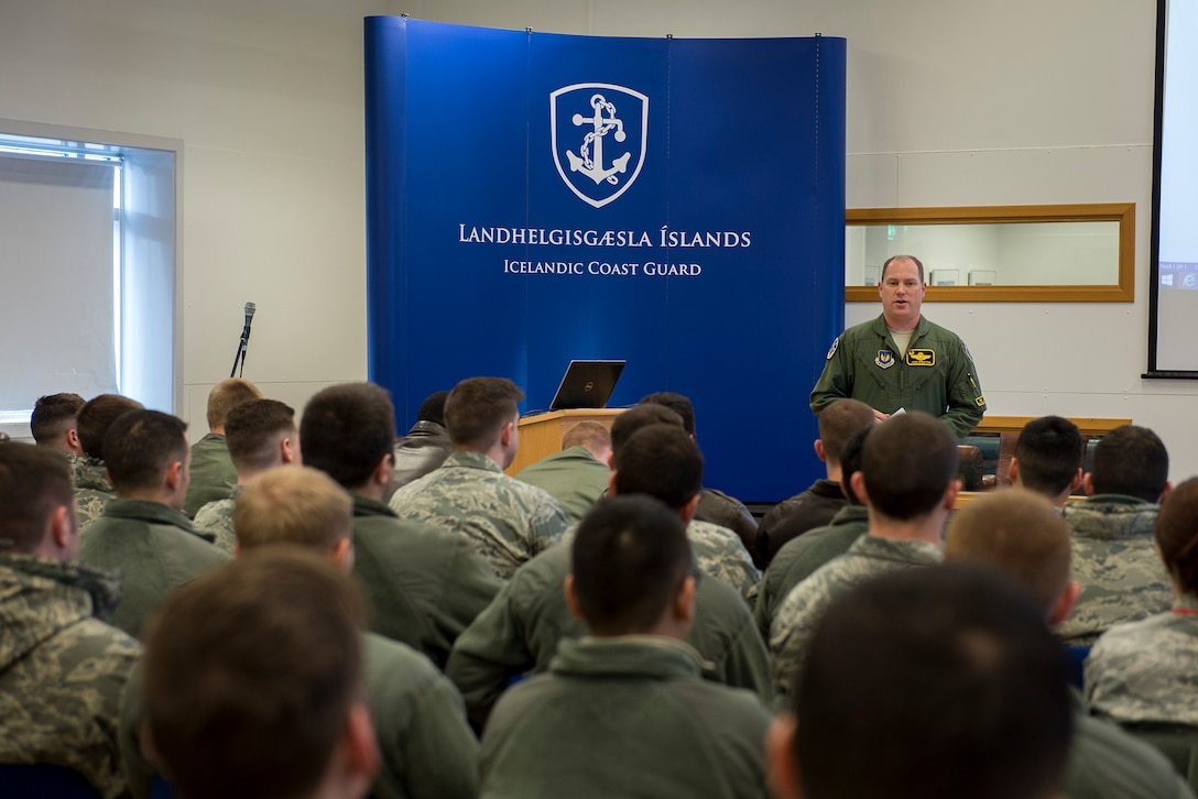 U.S. Air Force Lt. Col. John Stratton, 871st Air Expeditionary Squadron commander, speaks to deployed personnel at Keflavik, Iceland, in support of Icelandic Air Surveillance and Policing operations April 13, 2015. Four F-15C Eagle fighter aircraft from Royal Air Force Lakenheath, a KC-135 Stratotanker from RAF Mildenhall and approximately 200 U.S Airmen are deployed in support of IAS 2015 to ensure the safety and security of Icelandic airspace. (U.S. Air Force photo by Staff Sgt. Chad Warren/Released)