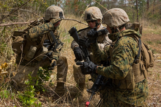 Combat engineer team leaders with Marine Wing Support Squadron 171, Engineer Company, combat engineer platoon, discus their plan of attack before assaulting an enemy position during a foot patrol and breaching drill on the Japan Ground Self-Defense Force's Haramura Maneuver Area in Hiroshima, Japan, as part of Exercise Haramura 1-15 April 15, 2015. Haramura is a weeklong company-level training exercise was focused on reinforcing the skills Marines learned during Marine Combat Training and their Military Occupational Specialty schooling.