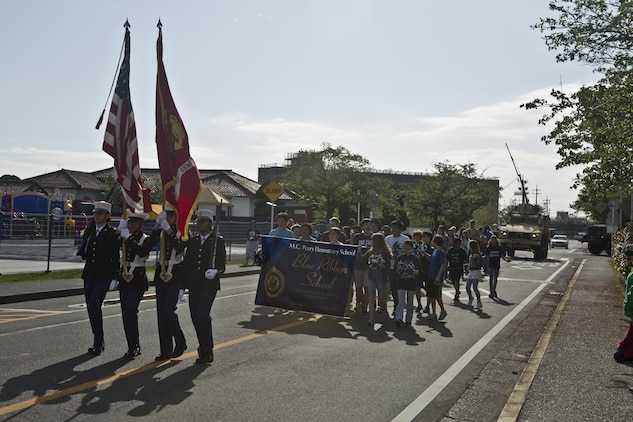 Students from the Matthew C. Perry Schools aboard Marine Corps Air Station Iwakuni, Japan, conduct a parade during their Blue Ribbon School of Excellence ceremony, April 21, 2015. The Department of Defense Education Activity nominates only three schools for the Blue Ribbon Schools of Excellence award annually, one from DoD Dependent School's Europe, one from DoDEA Pacific and one from Domestic Dependent Elementary and Secondary Schools and this year M. C. Perry was selected along with Aukamm Elementary School in Germany.