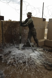 U.S. Air Force Master Sgt. Kent Hinshaw, a water and fuel system specialist attached to the 577th Expeditionary Prime Base Emergency Engineering Force Squadron, lifts a pipe out of a well as part of his mission to assess the well for an emergency water supply for the Operation Inherent Resolve Building Partner Capacity Mission aboard Al-Asad Airbase, Iraq, April 11, 2015. The BPC mission will train and enable Iraqi Security Force leadership skills, medical procedures, small unit tactics, air-ground integration, and equipping and sustainment procedures. (U.S. Marine Corps Photo by Cpl. Cansin P. Hardyegritag)