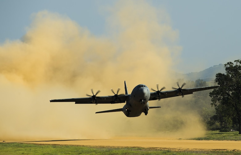 A C-130 Hercules takes off at Fort Hunter Liggett, Calif., during Exercise Golden Hydra on March 31, 2015. More than 130 Airmen from five wings across Air Mobility Command and the Air National Guard participated in a contingency response exercise March 29 through April 3 at three locations in California. (U.S. Air Force photo/Tech. Sgt. Matthew Hannen)